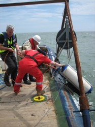 Retrieving equipment used to take images of the seafloor.